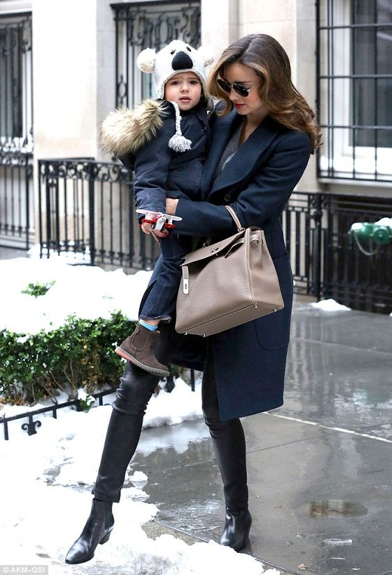Birthday bear! Miranda Kerr toted gorgeous son Flynn through the snow as they headed to dad Orlando Bloom's house in New York City on Sunday...