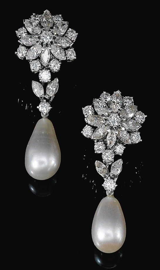 FINE PAIR OF NATURAL PEARL AND DIAMOND EARRINGS, 1960S. Of floral design, each surmount set with marquise-shaped and brilliant-cut diamonds, suspending a drop-shaped natural pearl measuring approximately 10.4 x 10.5 x 17.4mm and 9.75 x 10.0 x 15.8mm respectively, butterfly and post fittings.: