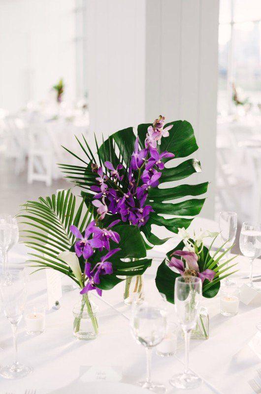 Tropical Wedding Centerpiece Idea Palm Leaves And Purple Flowers