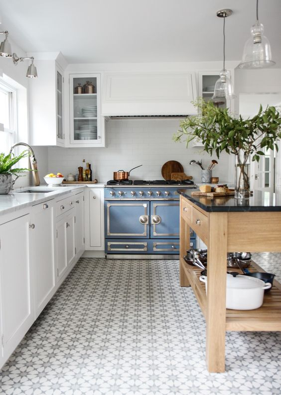 Kitchen with blue oven and open shelving