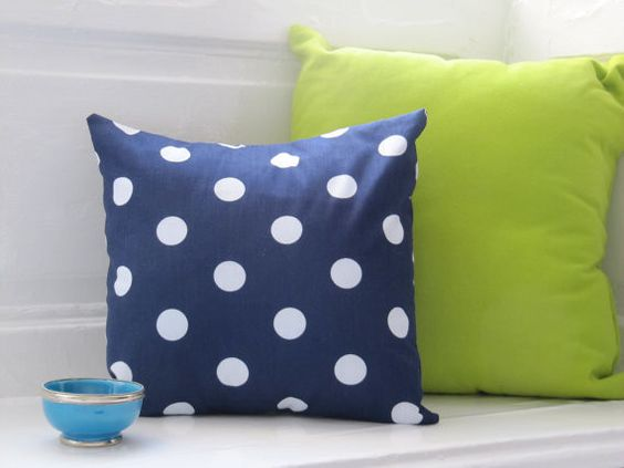 Throw a few polka dot pillows on a solid couch for a grown-up look, or go for a mismatched, bohemian vibe by pairing them with floral pillows.