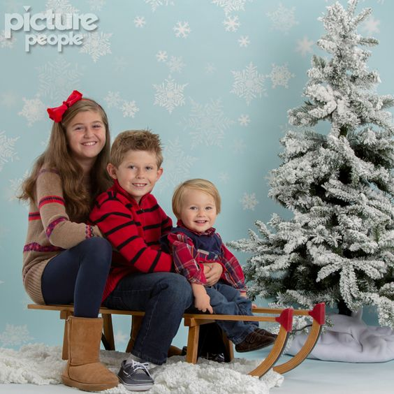 Holiday photo of kids on a wooden sled