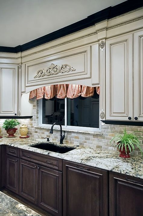 Two cabinet colors The vanilla marble with choco chip design is a wonderful selection to be made for almost any type of kitchen, no matter how big or small it is. The brown woodwork furnishing and neat beige interiors makes it look very neat.