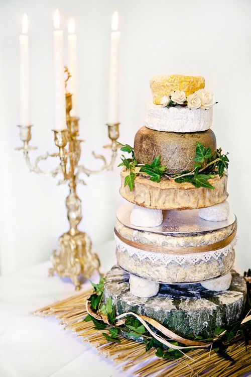 """""""cheese"""" cake.  i like the idea of elegantly displaying cheese for reception.  i would probably unstack to make it more accessible for eating and remove the ivy.  i am not fond of ivy."""