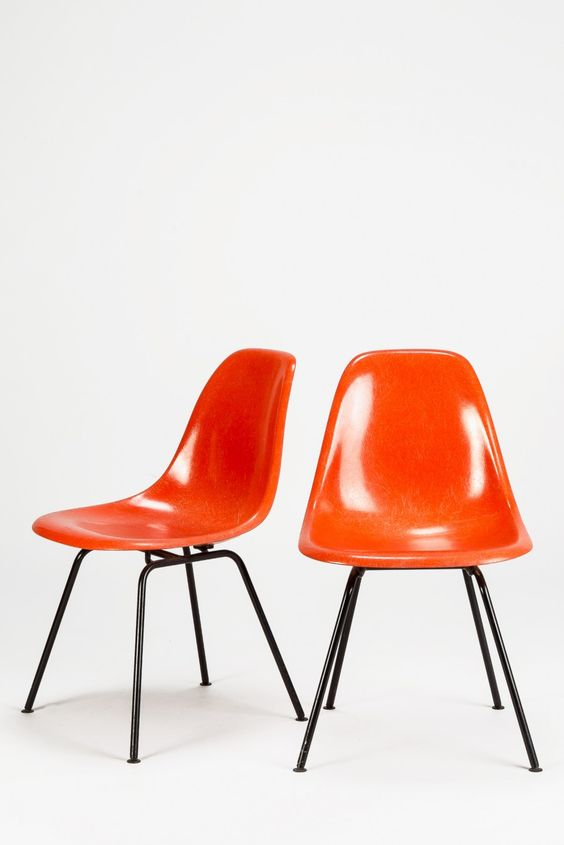 Eames orange shell chairs. @designerwallace