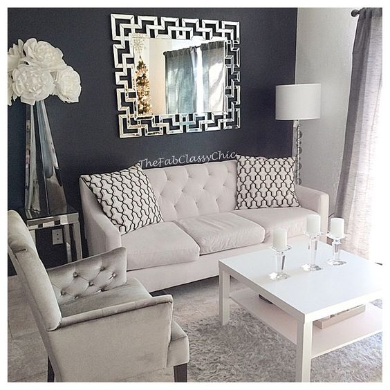 Dark Gray Accent wall with white decor. Light gray couch and printed throw pillow!: