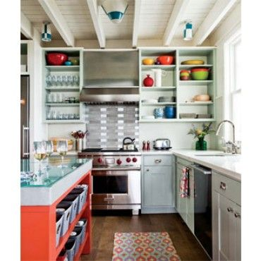 I love this kitchen because the color scheme seems very child friendly. The bright colors make it very inviting.