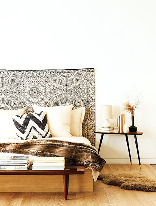 I love the idea f having a tapestry as a backboard this for Fur headboard