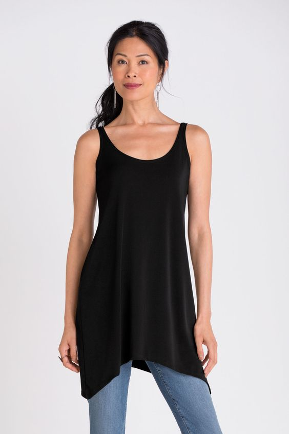 Crescent Tunic by Spirithouse. Defined by a crescent-shaped hem and deep scoop…: