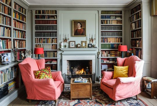 Room of the Day ~ salmony-pink slipcovers in this blue-gray library with…