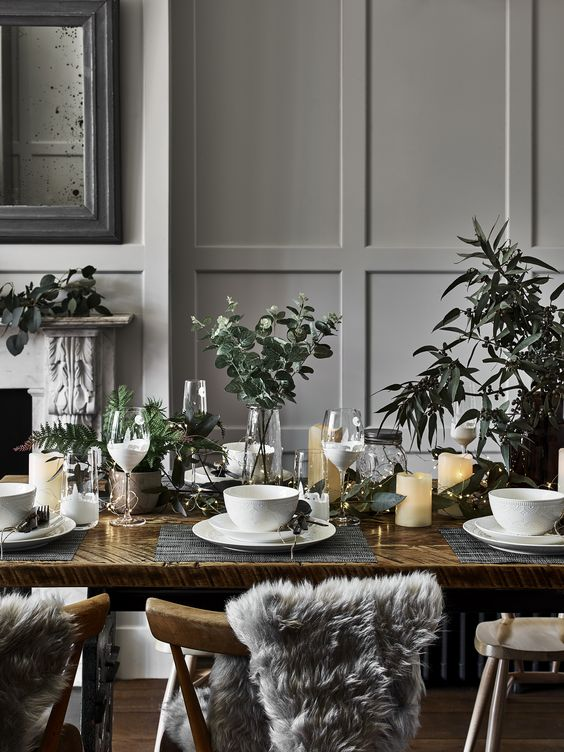 Planning a Christmas table setting? Bringing the outside in is such an effective, inexpensive way to make a space feel immediately more festive. Try strewing your table with some branches, stems of eucalyptus and pine cones for an on-trend Nordic look. #christmas #tablesetting #nordic #scandi #table #hosting #eucalyptus