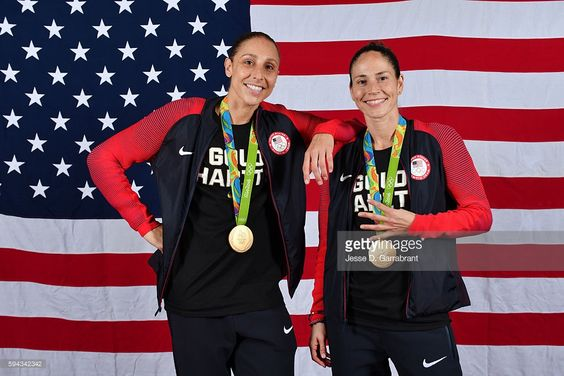 Diana Taurasi #12 and Sue Bird #6 of the USA Basketball Women's National Team pose after winning the Gold Medal at the Rio 2016 Olympic games on August 20, 2016.