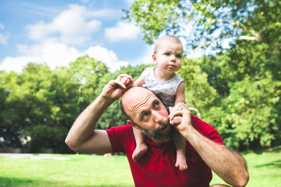 Little girl on Dad's shoulders | NYC Family Photographer