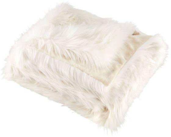Flauschig weiche Felldecke in Weiß - ein kuscheliger Begleiter!
