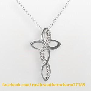 STERLING SILVER Crystal Infinity Cross Pendant Eternal Elegance.Sparkling crystals give this infinity cross pendant a gorgeous glow. Grace yourself with this Sterling Silver Necklace. Sterling Silver construction offers lasting shine. Details: 4/5 inch pendant, 18-inch chain, Spring ring clasp, Sterling Silver​. $50.00
