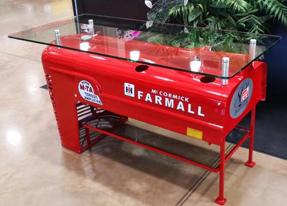"""Gyford StandOffs used to mount 1/2"""" glass and make a table from a tractor hood! Made by MGSI, Ltd."""
