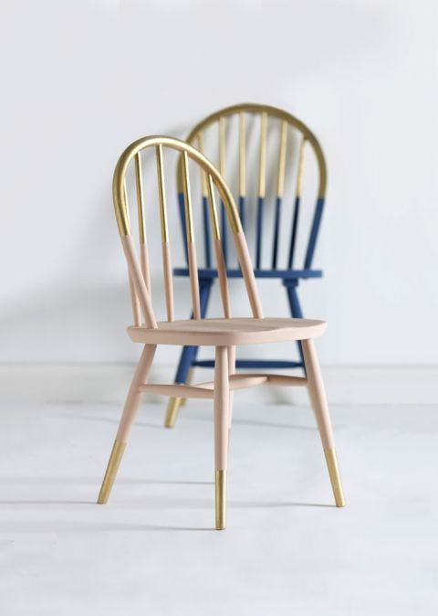 Update a wooden chair with a two-tone paint effect. Ensure thesurface is clean and dry, then paint the entire chair in your chosencolour. Use a low-tack masking tape to create a straight line across theback of the chair. Measure one third of the leg height and mask with tape and repeat for other legs. Paint the top and bottom sections in gold. This will need two coats. Before the second coat is fully dry, remove the tape gently to avoid the paint cracking. Finally, spray the...