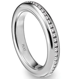 Platinum band by Steven Kretchmer Design featuring channel set stones.