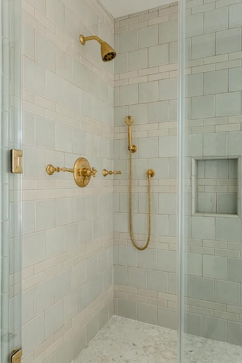 A Br Shower Kit Is Mounted To Gray