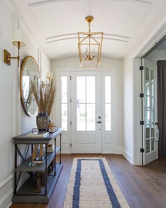 It S All About Making An Entrance And This Entryway Definitely Has It That Curved Ceiling With Those Rich Chocolat Foyer Decorating Foyer Lighting Home Decor