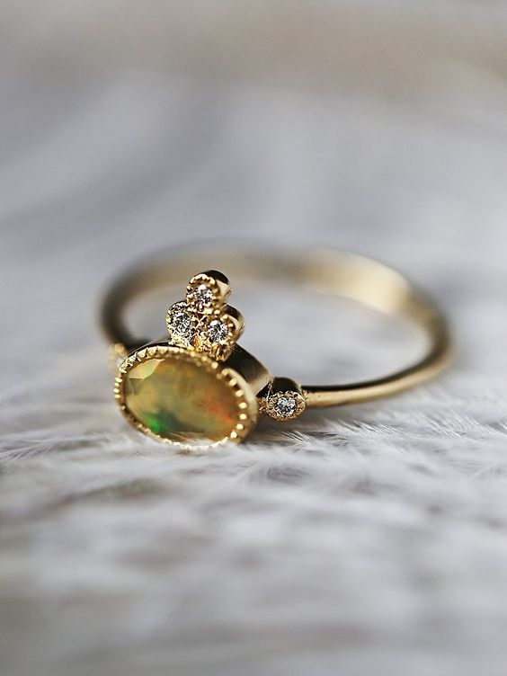 Opal Crown 5 Diamond Ring | Handmade in California, this beautiful 14k yellow gold ring features a large faceted opal stone surrounded by five radiantly light-catching diamonds. Delicate, femme band makes for a modern aesthetic.