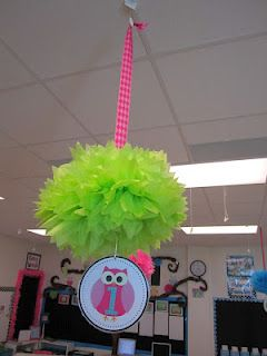 Poms hung by a ribbon with table number dangling below!