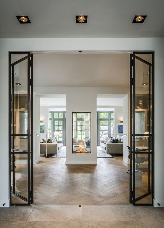 Modern direct vent Fireplace and black glass doors More