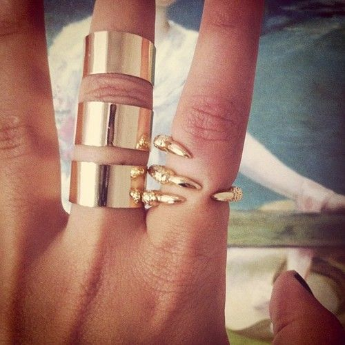 Gold claw ring.