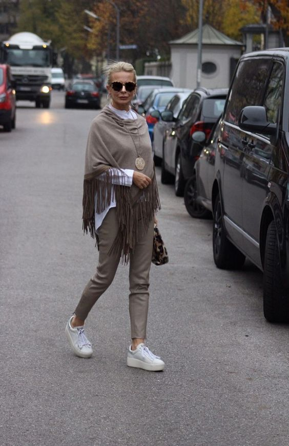 Taupe look ... with fringed poncho and leather pants ... platform sneakers ... chocolate ...