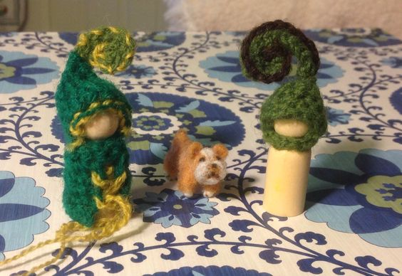Peg dolls I'm working on and a needle felted dog I made.  He's no bigger than a quarter. :-)