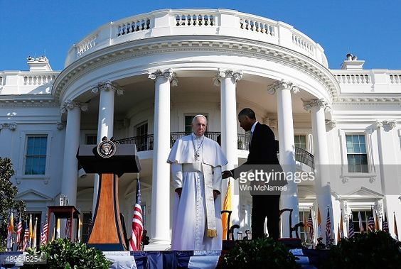 President Barack Obama (R) welcomes Pope Francis (L) during an arrival ceremony at the White House on September 23, 2015 in Washington, DC. The Pope begins his first trip to the United States at the White House followed by a visit to St. Matthew's Cathedral, and will then hold a Mass on the grounds of the Basilica of the National Shrine of the Immaculate Conception.