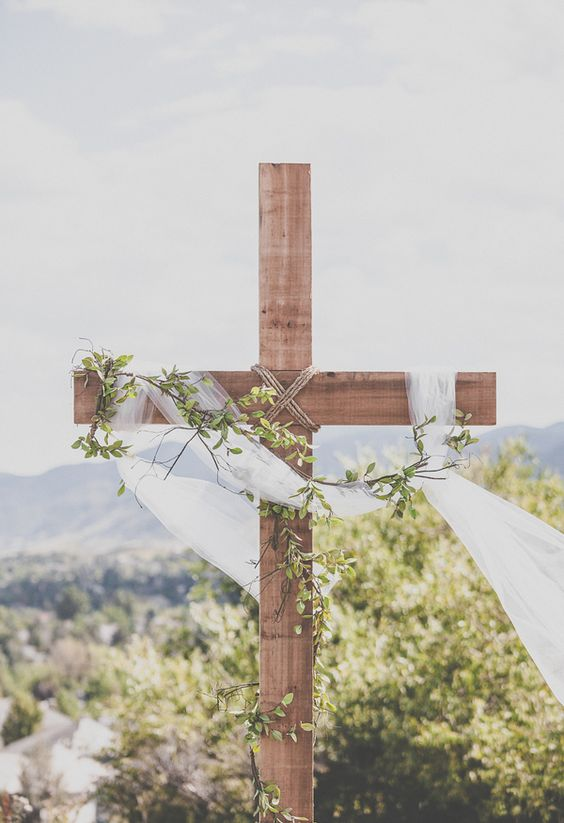 Wooden cross, white flowing fabric, leaves // Alicia Gines Photography