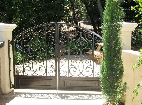 Gate Design Ideas the modern day gates for bungalows are generally big having the cylindrical cone like structure over the top and provide the complete view with small spaces Fence Wrought Iron Arch Gate Design Arched Gate Design Ideas Driveway Gates Iron Gate