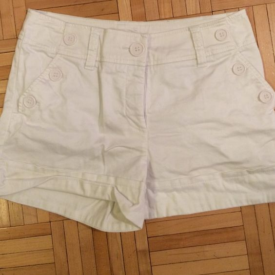 White sailor style shorts White shorts are a summer staple! These are so cute with the buttons and cuffs! Worn once, absolutely no stains or marks on the white. 13 inches from waist, 3 inch inseam. Remember H&M runs small! H&M Shorts