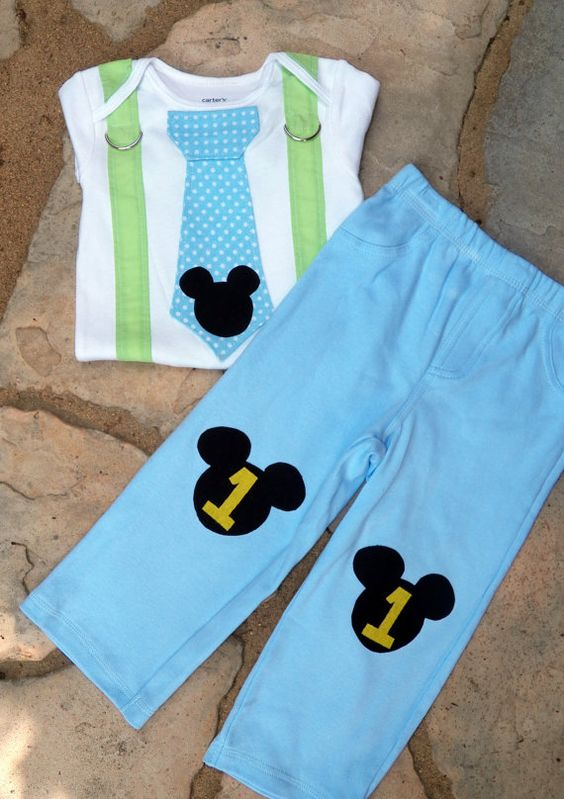 Mickey's First Birthday is a baby blue and yellow themed party kit that caters to eight guests. The standard kit comes with square cake plates that have Mickey Mouse and the number one on them, Mickey napkins and cups, and baby blue utensils.