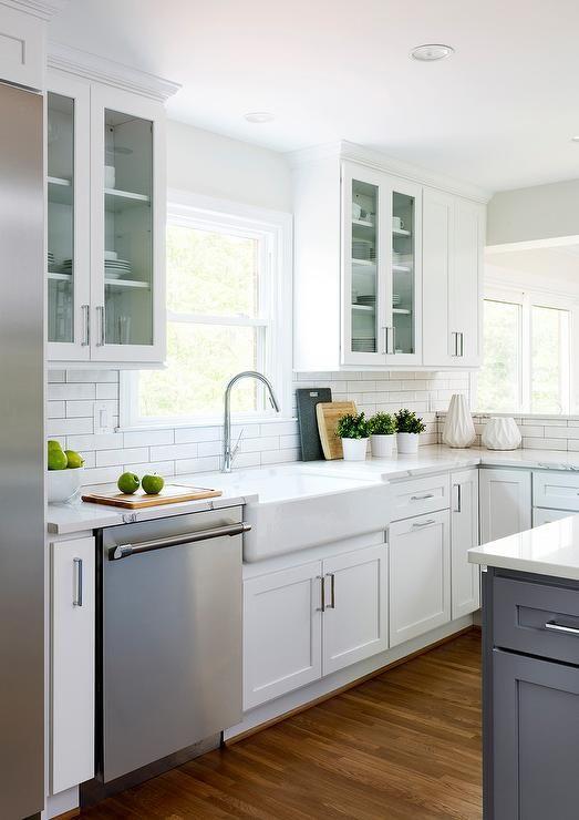 A Stainless Steel Dishwasher Displayed Next To A Farmhouse Kitchen Sink Surrounding White Shaker Cabinets Kitchen Remodel Farmhouse Sink Kitchen Kitchen Design