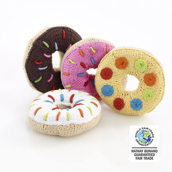 This fabulous knitted donut rattle is a great size for babies to grab and chew. An ideal toy for tummy time.Handmade, fair trade and suitable from birth. Machine washable. Tested to EN71 and CEApproximate size: height approx. 6cm, width approx.