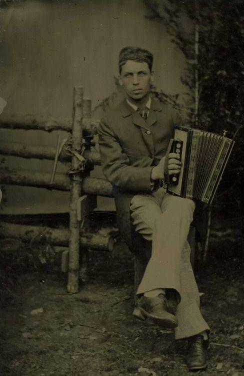 1bohemian:  Accordion player. 1880s.