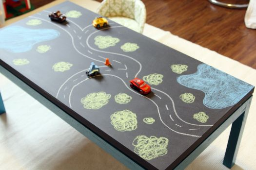 Repaint a coffee table with chalk board paint. Draw a road, game boards, self portraits, work out homework problems, or just let the kids go wild. It will keep them entertained for hours. {toy/playroom idea}