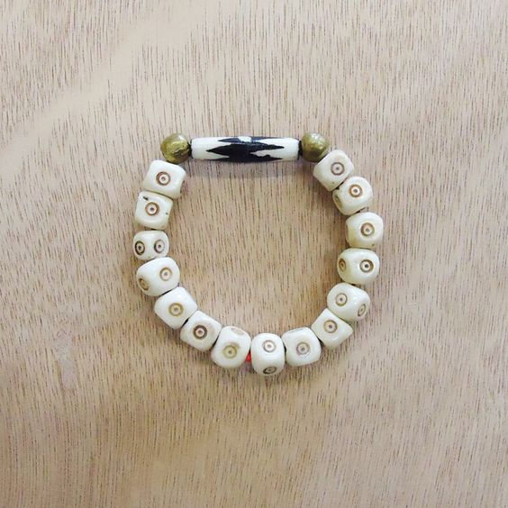 SAFARI // made with carved bone beads with handmade Ethiopian brass accent beads by Congolese refuge women // www.gaiaforwomen.com