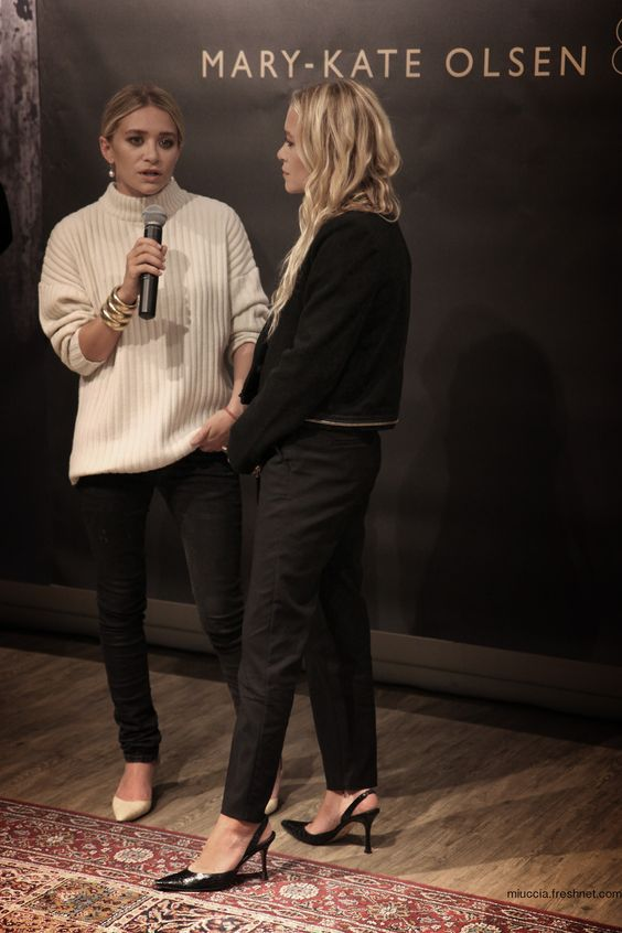 Ashley and Mary-Kate Olsen, cream pullover on skinny jeans. slingback heels