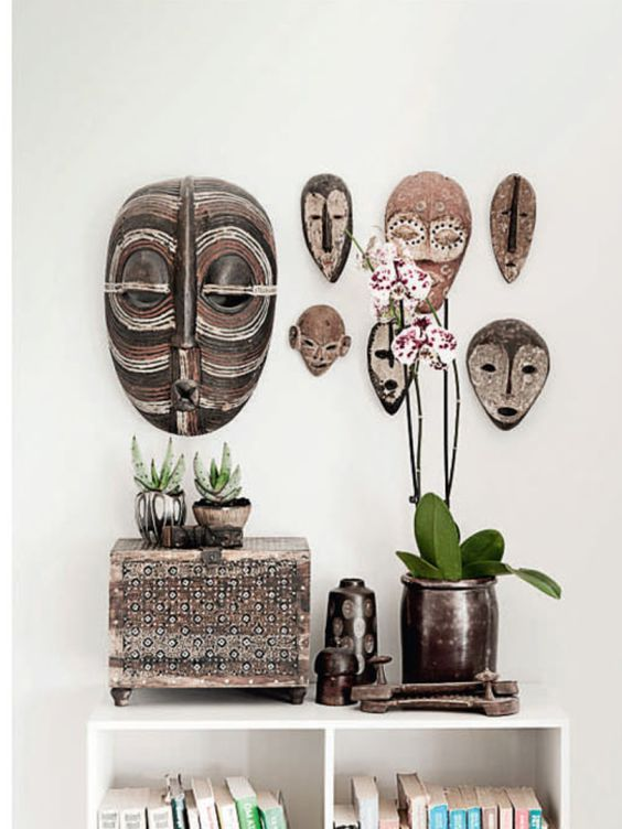 African masks as wall art gives this space stylish vibe @pattonmelo