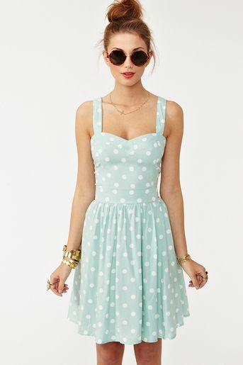I love this mint polka dotted a-line dress! So very 60's pin-up! #purefection #modcloth