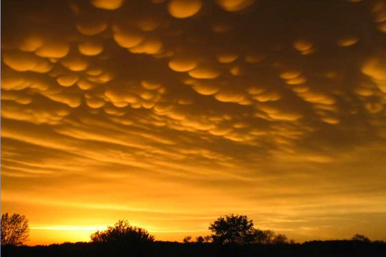 Mammantus clouds are usually associated with severe weather, but before the severe thunderstorms, the clouds appear to look like round, magical tufts.