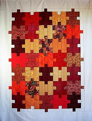 Quilter's Puzzle Quilt Top by Carol A Ashley on Flicker.  Each block is made of just three pieces.  What could be easier?