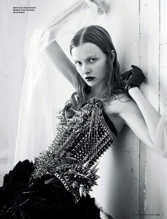 Spiked corset. Love her look.