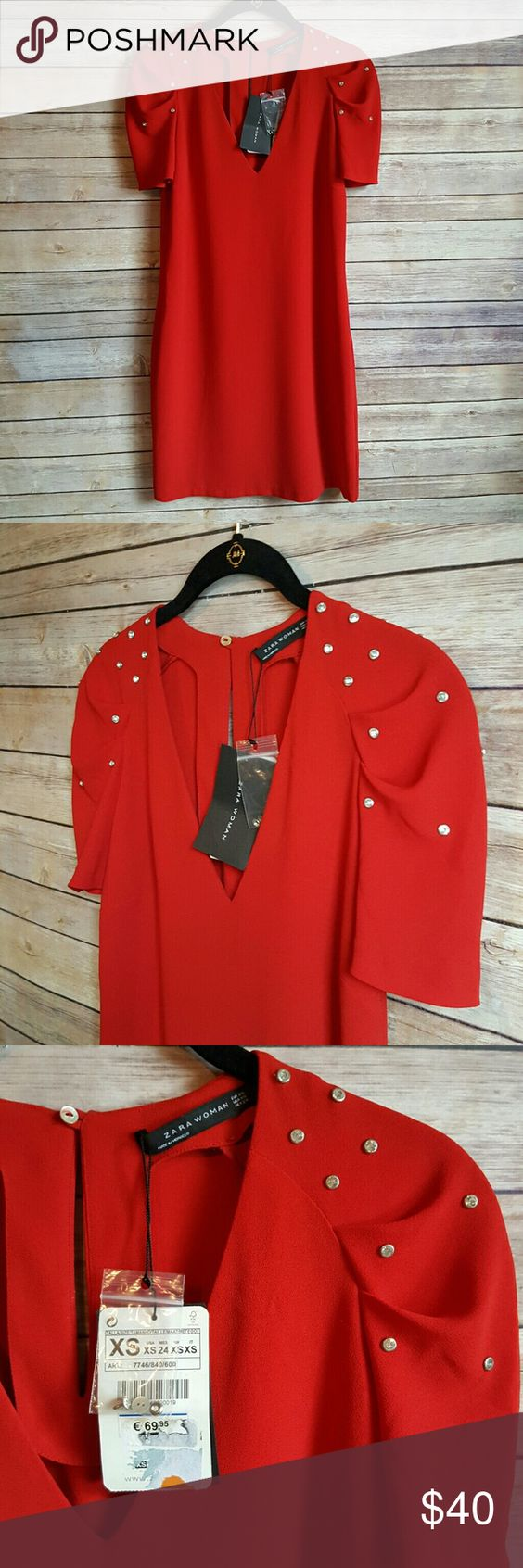 """NWT Zara Red Dress Beautiful red (a little deeper red than the photos show) v-neck dress. Has cool crystal studded sleeve detail and keyhole back. Measures 33"""" long and 17"""" armpit to armpit. Would fit a size small as well, in my opinion. Zara Dresses Midi"""
