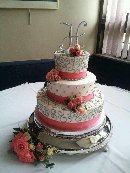 Cake designed by Cakes by Candice. Spray rose and beaded Garland floral accents.