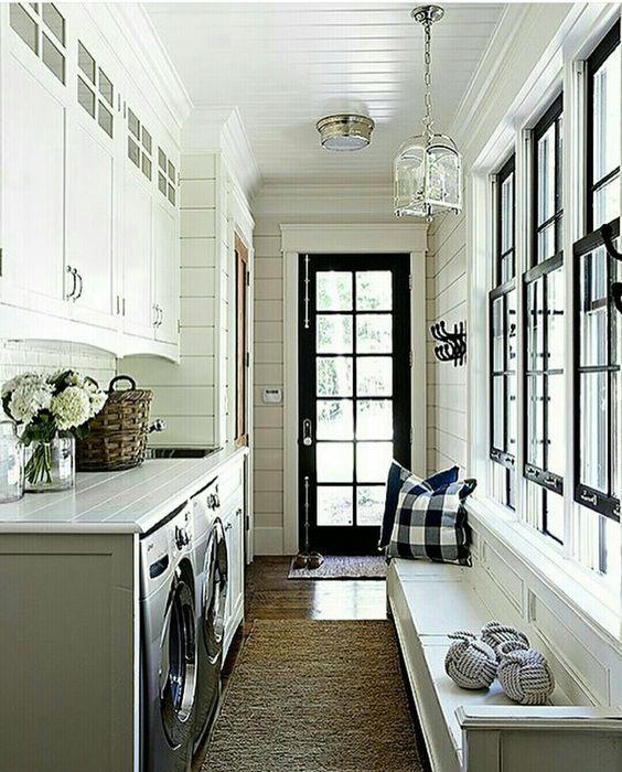 Sarah Richardson. Laundry/Mudroom/Hallway with shiplap walls, black trim, and built-in bench. #mudroom #laundryroom #modernfarmhouse #shiplap