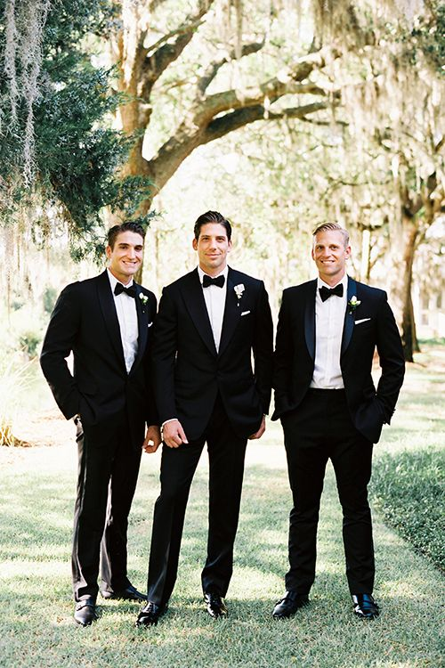 The groom and his groomsmen in tuxedos   Brides.com